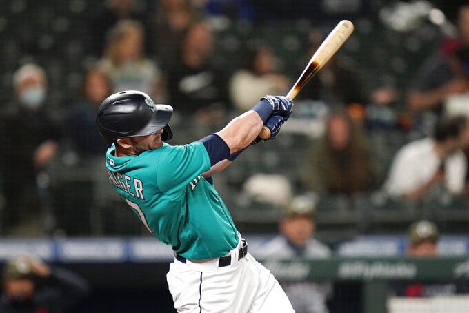 Seattle Mariners' Mitch Haniger hits a two-run home run against the Cleveland Indians during the seventh inning of a baseball game Friday, May 14, 2021, in Seattle. (AP Photo/Elaine Thompson)