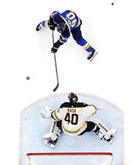 Boston Bruins goaltender Tuukka Rask (40), of Finland, blocks a shot in front of St. Louis Blues center Ryan O'Reilly (90) during the first period of Game 6 of the NHL hockey Stanley Cup Final Sunday, June 9, 2019, in St. Louis. (AP Photo/Jeff Roberson)