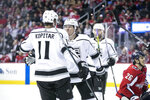 Los Angeles Kings right wing Tyler Toffoli (73) celebrates with center Anze Kopitar (11) after scoring a goal during the first period of an NHL hockey game against the Washington Capitals, Monday, Feb. 11, 2019, in Washington. (AP Photo/Al Drago)