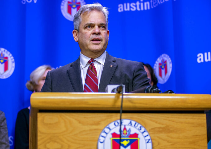 """FILE - In this March 6, 2020, file photo, Austin Mayor Steve Adler speaks during a press conference in Austin, Texas. Adler took a vacation to Mexico with family in November at a time when he was urging people to """"stay home if you can."""" The trip revealed by the Austin-American Statesman on Wednesday, Dec. 2, 2020, comes after California Gov. Gavin Newsom, another public official who has also pleaded with his residents to resist the temptation to socialize, acknowledged last month that he attended a birthday party at a posh restaurant with friends. (Ricardo B. Brazziell/Austin American-Statesman via AP, File)"""