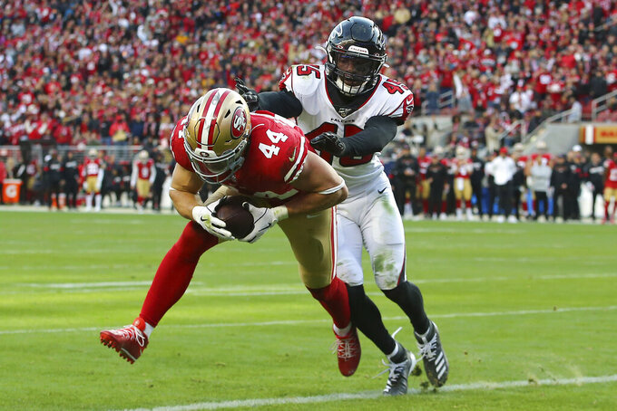 San Francisco 49ers fullback Kyle Juszczyk (44) scores in front of Atlanta Falcons linebacker Deion Jones (45) during the second half of an NFL football game in Santa Clara, Calif., Sunday, Dec. 15, 2019. (AP Photo/John Hefti)