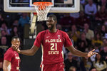 Florida State center Christ Koumadje (21) reacts to a call during the first half of an NCAA college basketball game against Georgia Tech Saturday, Feb. 16, 2019, in Atlanta. (AP Photo/Danny Karnik)