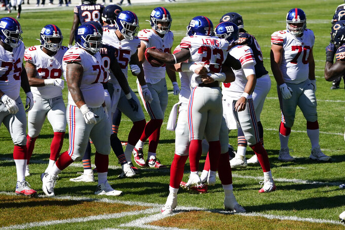 New York Giants running back Dion Lewis (33) celebrates his one-yard touchdown run during the second half of an NFL football game against the Chicago Bears in Chicago, Sunday, Sept. 20, 2020. (AP Photo/Charles Rex Arbogast)