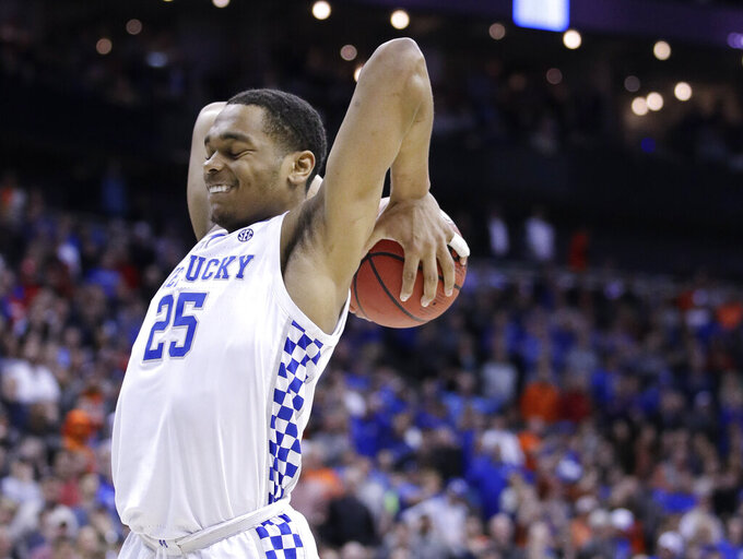 Kentucky's PJ Washington reacts after missing a basket during overtime of the Midwest Regional final game against Auburn in the NCAA men's college basketball tournament Sunday, March 31, 2019, in Kansas City, Mo. (AP Photo/Charlie Riedel)