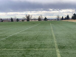 In this photo provided by the Broomfield Police Department on Twitter, debris is scattered across a turf field at Commons Park, Saturday, Feb. 20, 2021, in Broomfield, Colo. The police ask that the area be avoided if possible.  A commercial airliner dropped debris in Colorado neighborhoods during an emergency landing Saturday. The Broomfield Police Department said on Twitter that the plane landed safely at Denver International Airport and that no injuries had been reported from the incident. (Broomfield Police Department via AP)