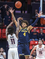 Michigan forward Isaiah Livers (4) defends the pass of Illinois guard Ayo Dosunmu (11) during the second half of an NCAA college basketball game in Champaign, Ill., Thursday, Jan. 10, 2019. Michigan won 79-69. (AP Photo/Rick Danzl)