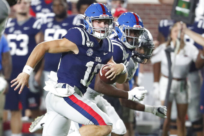 Mississippi quarterback John Rhys Plumlee (10) looks downfield for Vanderbilt defenders he scores a touchdown on a 33-yard run during the first half of an NCAA college football game in Oxford, Miss., Saturday, Oct. 5, 2019. (AP Photo/Rogelio V. Solis)