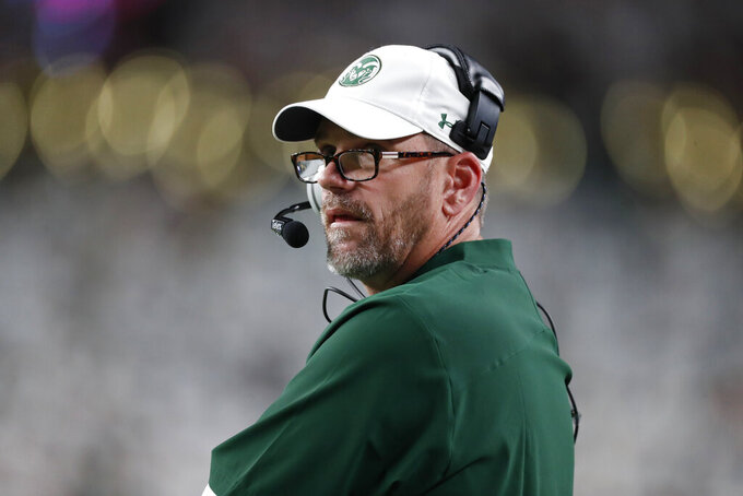 Colorado State head coach Mike Bobo looks on in the first quarter of an NCAA college football game against Colorado, Friday, Aug. 30, 2019, in Denver. (AP Photo/David Zalubowski)