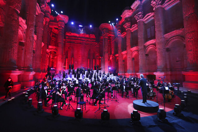 Musicians from the Lebanese Philharmonic Orchestra perform during a concert in the ancient northeastern city of Baalbek, Lebanon, Sunday, July 5, 2020. Dubbed