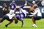 Minnesota Vikings running back Dalvin Cook, center, is upended after catching a pass as Chicago Bears cornerback Kyle Fuller, left, and defensive back Deon Bush, right, defend during the half of an NFL football game Sunday, Sept. 29, 2019, in Chicago. (AP Photo/Matt Marton)