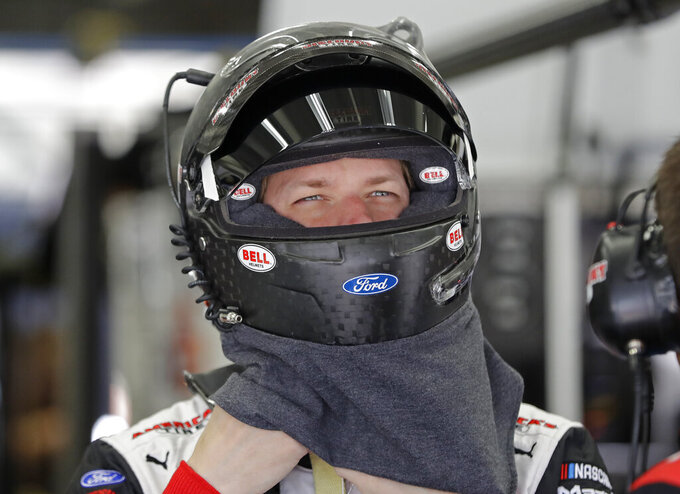Brad Keselowski prepares before practice for Saturday's NASCAR All-Star Cup series auto race at Charlotte Motor Speedway in Concord, N.C., Friday, May 17, 2019. (AP Photo/Chuck Burton)