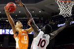 FILE - In this Feb. 27, 2021, file photo, Tennessee guard Jaden Springer (11) puts up a shot over Auburn forward JT Thor (10) during the second half of an NCAA basketball game in Auburn, Ala. Springer played one season with the Volunteers and is one of the top shooting guards in the NBA draft. (AP Photo/Butch Dill, File)