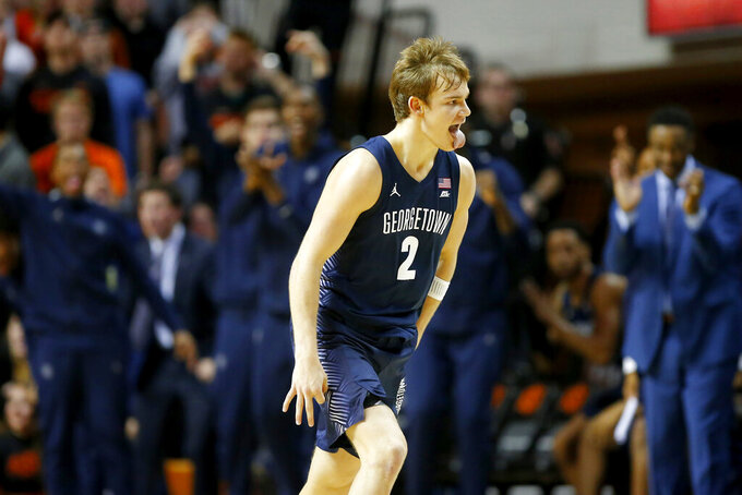Georgetown's Mac McClung (2) celebrates after making a basket against Oklahoma State during an NCAA college basketball game in Stillwater, Okla., Wednesday, Dec. 4, 2019. (Bryan Terry/The Oklahoman via AP)