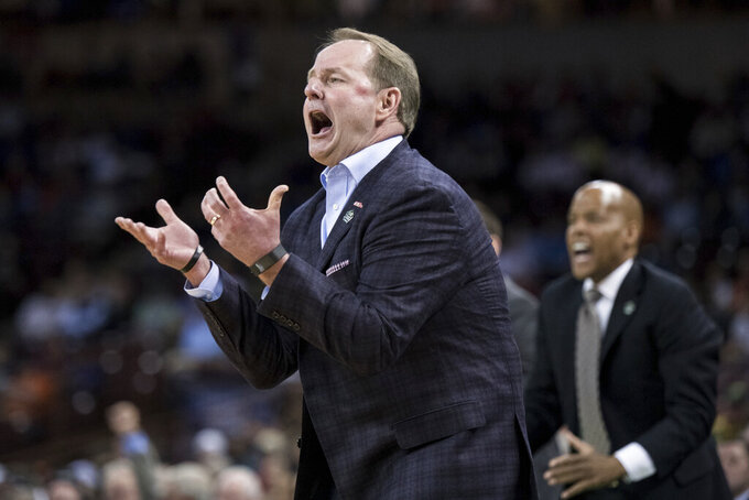Mississippi head coach Kermit Davis reacts after a play against Oklahoma during a first round men's college basketball game in the NCAA Tournament Friday, March 22, 2019, in Columbia, S.C. (AP Photo/Sean Rayford)