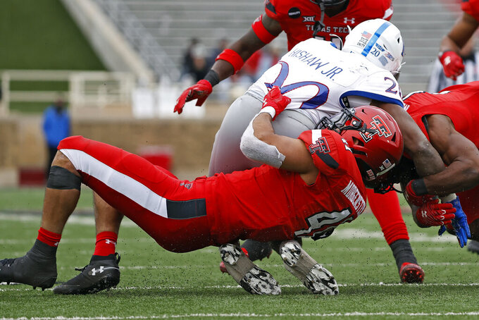 Texas Tech's Jacob Morgenstern (41) tackles Kansas' Daniel Hishaw Jr. (20) during the second half of an NCAA college football game Saturday, Dec. 5, 2020, in Lubbock, Texas. (AP Photo/Brad Tollefson)