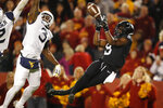 Iowa State wide receiver Deshaunte Jones, right, catches a 32-yard touchdown pass in front of West Virginia safety Toyous Avery Jr. (3) during the second half of an NCAA college football game, Saturday, Oct. 13, 2018, in Ames, Iowa. (AP Photo/Charlie Neibergall)
