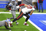 Tampa Bay Buccaneers tight end Rob Gronkowski (87) pulls away from Detroit Lions strong safety Duron Harmon to score during the second half of an NFL football game, Saturday, Dec. 26, 2020, in Detroit. (AP Photo/Lon Horwedel)
