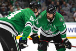 Dallas Stars center Roope Hintz (24) and left wing Jamie Benn (14) talk before a faceoff during the second period of an NHL hockey game against the Ottawa Senators in Dallas, Monday, Oct. 21, 2019. (AP Photo/Sam Hodde)