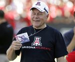 FILE - In this Oct. 9, 2010, file photo, former Arizona football head coach Dick Tomey, is seen back in Arizona Stadium for the 1st time since 2000, jokes on the sidelines before the NCAA college football game against Oregon State in Tucson, Ariz. Tomey, the winningest football coach in University of Arizona history, died Friday night, May 10, 2019, in Tucson, Ariz. He was 80. Tomey was 183-145-7 overall in 20 years as head coach at Hawaii, Arizona and San Jose State. He was diagnosed with lung cancer in December.   (AP Photo/John Miller, File)