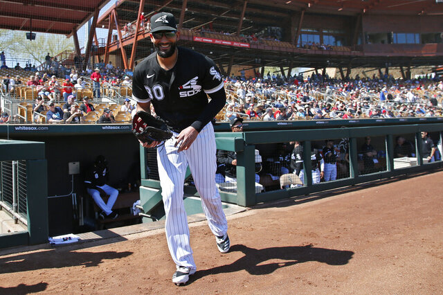 FILE - In this Monday, March 9, 2020 file photo, Chicago White Sox's Nomar Mazara heads out of the dugout for a spring training baseball game against the Cincinnati Reds in Glendale, Ariz. The Chicago White Sox declined to offer 2021 contracts to right fielder Nomar Mazara and pitcher Carlos Rodón on Wednesday, Dec. 2, 2020, sending the pair into free agency.(AP Photo/Sue Ogrocki, File)