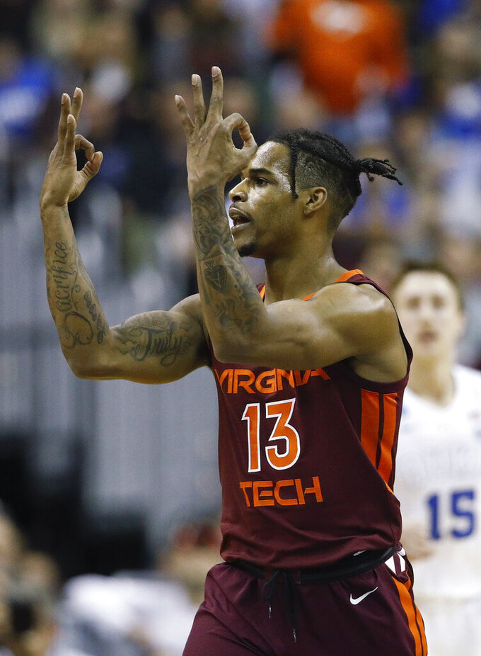 Virginia Tech guard Ahmed Hill gestures after scoring against Duke during the first half of an NCAA men's college basketball tournament East Region semifinal in Washington, Friday, March 29, 2019. (AP Photo/Patrick Semansky)