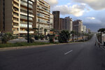 A street is almost empty of cars during an 11-day nationwide shutdown aimed at curbing the spread of the coronavirus, in Beirut, Lebanon, Friday, Jan. 15, 2021. Lebanon's parliament has approved a draft law to allow the importing of vaccines into the tiny country to fight the spread of coronavirus. (AP Photo/Bilal Hussein)