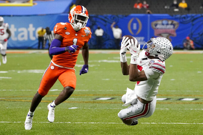 Ohio State wide receiver Garrett Wilson catches a pass in front of Clemson cornerback Derion Kendrick during the first half of the Sugar Bowl NCAA college football game Friday, Jan. 1, 2021, in New Orleans. (AP Photo/John Bazemore)