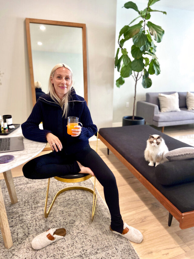 In this April 5, 2020 photo, Goop fashion director Ali Pew is poses in Los Angeles. After weeks stuck in isolation, bodies molded into beds and couches glued to TVs and computers, with little to delineate weekends from weekdays, a pronounced fashion trend is emerging in loungewear. It's comfy, everyday clothing with a bit more refinement, unfussy, minimal, but pulled together enough for a zoom conference call with your boss. (Oliver Clark via AP)