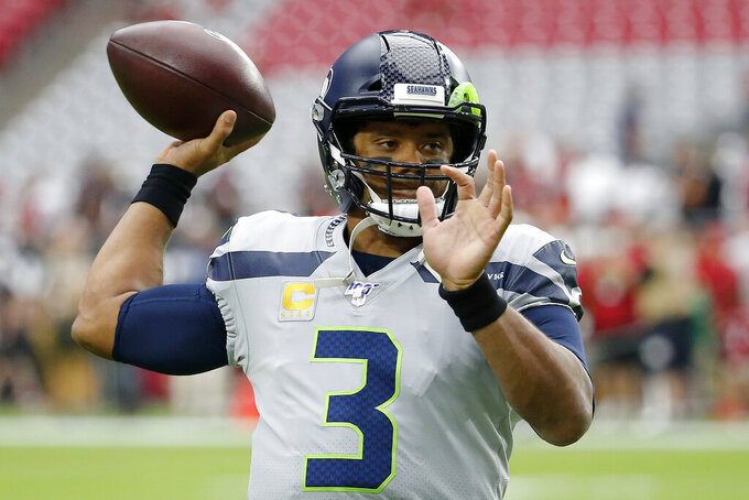 Seattle Seahawks quarterback Russell Wilson (3) warms up prior an NFL football game against the Arizona Cardinals, Sunday, Sept. 29, 2019, in Glendale, Ariz. (AP Photo/Rick Scuteri)
