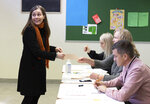 Iceland's Prime Minister Katrin Jakobsdottir casts her vote at a polling station in Reykjavik, Iceland, Saturday, Sept. 25, 2021. Icelanders are voting in a general election dominated by climate change, with an unprecedented number of political parties likely to win parliamentary seats. (AP Photo/Arni Torfason)