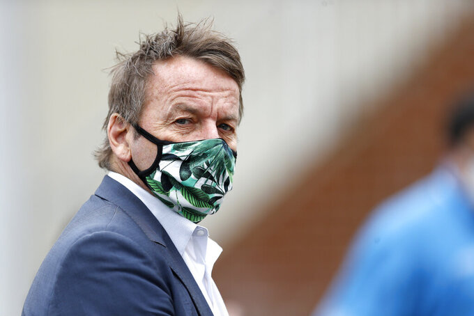 Annapolis Mayor Gavin Buckley is seen wearing a face mask as he visits a walk-up coronavirus testing center, Monday, April 20, 2020, in Annapolis, Md. According to the City of Annapolis Office of Emergency Management, the testing site began with a limited number of tests for people with symptoms on Monday. (AP Photo/Julio Cortez)