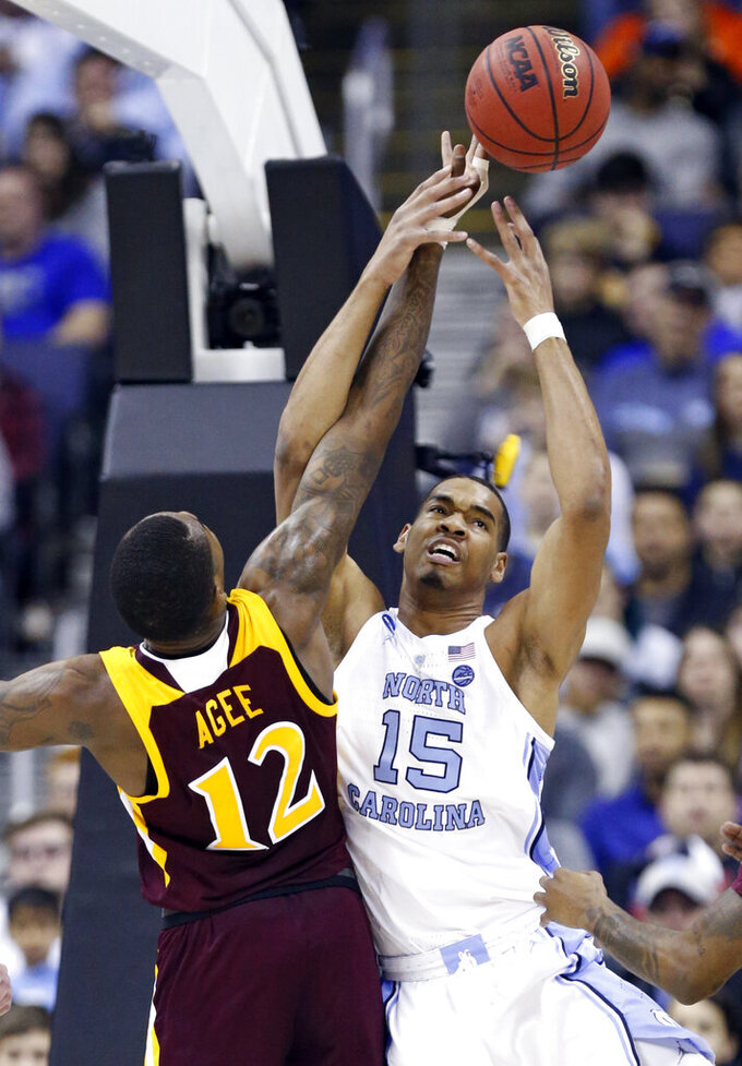 North Carolina's Garrison Brooks (15) and Iona's Tajuan Agee (12) battle for the ball in the first half during a first round men's college basketball game in the NCAA Tournament in Columbus, Ohio, Friday, March 22, 2019. (AP Photo/Paul Vernon)