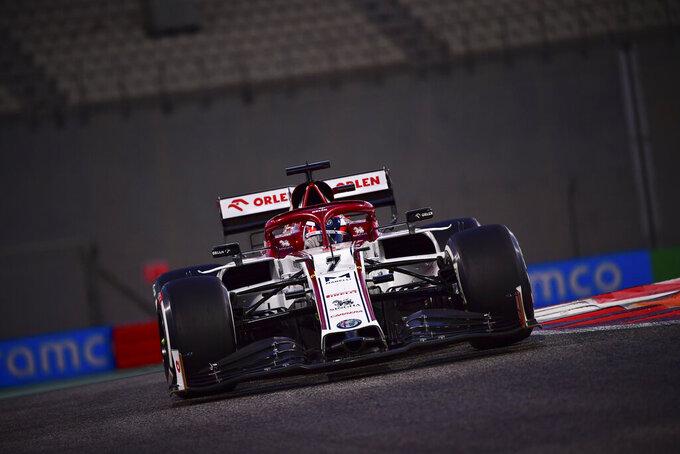 Alfa Romeo driver Kimi Raikkonen of Finland in action during second practice at the Formula One Abu Dhabi Grand Prix in Abu Dhabi, United Arab Emirates, Friday, Dec, 10, 2020. (Giuseppe Cacace, Pool via AP)