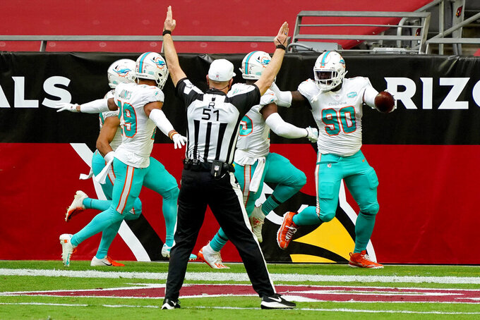 Miami Dolphins defensive end Shaq Lawson (90) celebrates his fumble recovery for a touchdown against the Arizona Cardinals during the first half of an NFL football game, Sunday, Nov. 8, 2020, in Glendale, Ariz. (AP Photo/Rick Scuteri)