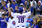 Chicago Cubs' Frank Schwindel (18) celebrates after hitting a grand slam during the seventh inning of a baseball game against the Pittsburgh Pirates in Chicago, Sunday, Sept. 5, 2021. (AP Photo/Nam Y. Huh)