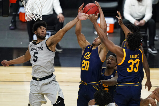 Colorado's D'Shawn Schwartz (5), California's Matt Bradley (20) and D.J. Thorpe (33) vie for a rebound during the second half of an NCAA college basketball game in the quarterfinal round of the Pac-12 men's tournament Thursday, March 11, 2021, in Las Vegas. (AP Photo/John Locher)