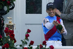 Jockey John Velazquez sprays champagne after winning the 147th running of the Kentucky Derby on Medina Spirit at Churchill Downs, Saturday, May 1, 2021, in Louisville, Ky. (AP Photo/Brynn Anderson)