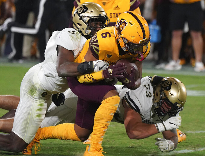 Arizona State wide receiver LV Bunkley-Shelton (6) is brought down by Colorado safety Mark Perry (5) and linebacker Nate Landman during the second half of an NCAA college football game Saturday, Sept. 25, 2021, in Tempe, Ariz. (AP Photo/Darryl Webb)