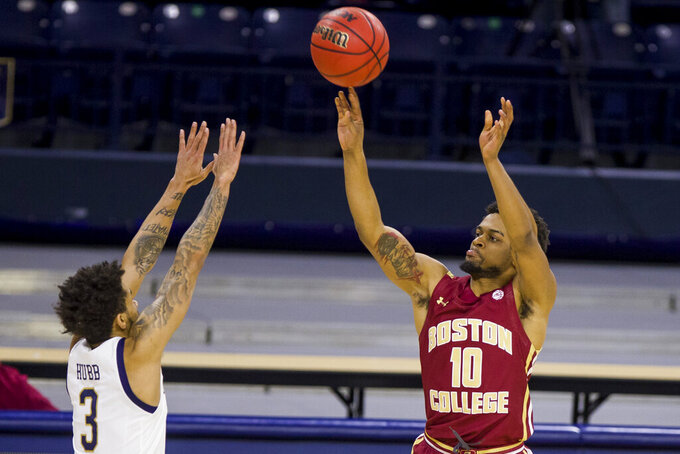Boston College's Wynston Tabbs (10) shoots a three-point basket over Notre Dame's Prentiss Hubb (3) during the second half of an NCAA college basketball game Saturday, Jan. 16, 2021, in South Bend, Ind. (AP Photo/Robert Franklin)