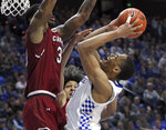 Kentucky's PJ Washington, right, shoots under pressure from South Carolina's Chris Silva during the second half of an NCAA college basketball game in Lexington, Ky., Tuesday, Feb. 5, 2019. Kentucky won 76-48. (AP Photo/James Crisp)