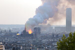 FILE - In this file photo dated Monday, April 15, 2019, Notre Dame cathedral is burning in Paris.  After more than two-years of work to stabilize and protect it after the shocking fire that tore through its roof and knocked down its spire, France's Notre Dame Cathedral is finally stable and secure enough for artisans to start rebuilding it, according to a government statement Saturday Sept. 18, 2021. (AP Photo/Rafael Yaghobzadeh, FILE)