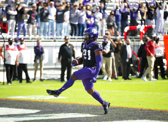 TCU running back Daimarqua Foster (21) scores a touchdown during the first half of an NCAA College football game against Oklahoma, Saturday, Oct. 24, 2020, in Fort Worth, Texas. (AP Photo/Brandon Wade)