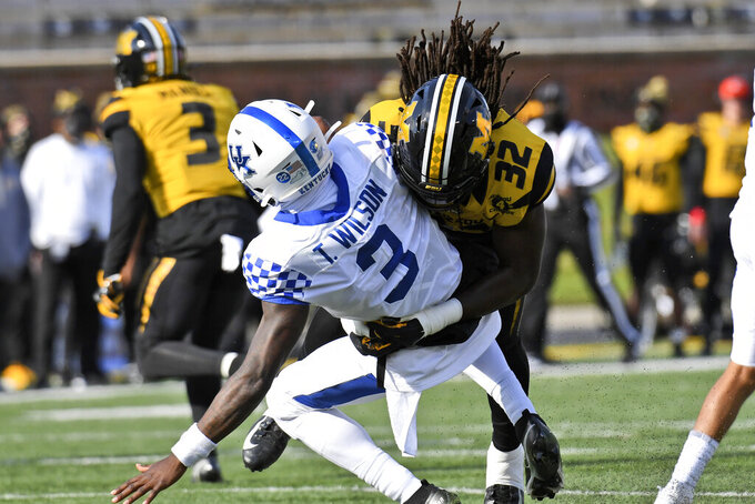 Kentucky quarterback Terry Wilson (3) is hit by Missouri linebacker Nick Bolton (32) during the first half an NCAA college football game Saturday, Oct. 24, 2020, in Columbia, Mo. (AP Photo/L.G. Patterson)