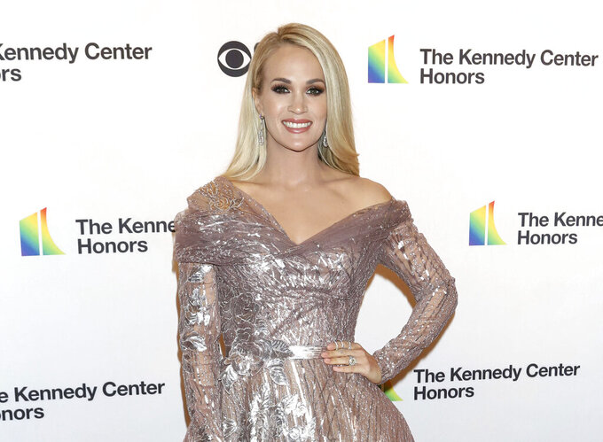 "FILE - Carrie Underwood attends the 42nd Annual Kennedy Center Honors in Washington on Dec. 8, 2019. Underwood released her first album of gospel music called ""My Savior,"" on Friday, March 26. (Photo by Greg Allen/Invision/AP, File)"