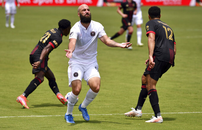 Inter Miami forward Gonzalo Higuain (9) reacts to a pass that was intercepted by Atlanta United defender George Bello (21) during the first half of an MLS soccer match, Sunday, May 9, 2021, in Fort Lauderdale, Fla. (AP Photo/Jim Rassol)