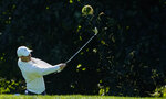 Rory McIlroy, of Northern Ireland, hits out of the rough on the 14th hole during the third round of the US Open Golf Championship, Saturday, Sept. 19, 2020, in Mamaroneck, N.Y. (AP Photo/Charles Krupa)