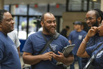 In this Friday, July 19, 2019 photo, from left to right: Dennis Sigur, Nicholas Jackson and Joshua Lewis participate in Tennessee State University's coding and app development initiative, in Nashville, Tenn. The school aims to be a hub for coding and app development at the nation's historically black colleges and universities. (Aaron Ingram/Apple via AP)