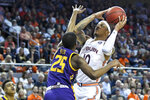 Lipscomb guard Miles Miller (25) defends against a shot by Auburn guard Samir Doughty (10) during the second half of an NCAA college basketball game Sunday, Dec. 29, 2019, in Auburn, Ala. (AP Photo/Julie Bennett)