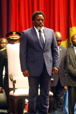 Congo's President Joseph Kabila waits to address the National Assembly in Kinshasa, Democratic Republic of Congo, Thursday, July 19, 2018. Congo's President Joseph Kabila in a national address says the long-delayed December election is
