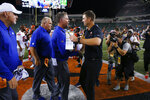 New York Giants coach Pat Shurmur, center left, and Cincinnati Bengals coach Zac Taylor, center right, meet after an NFL preseason football game Thursday, Aug. 22, 2019, in Cincinnati. (AP Photo/Gary Landers)